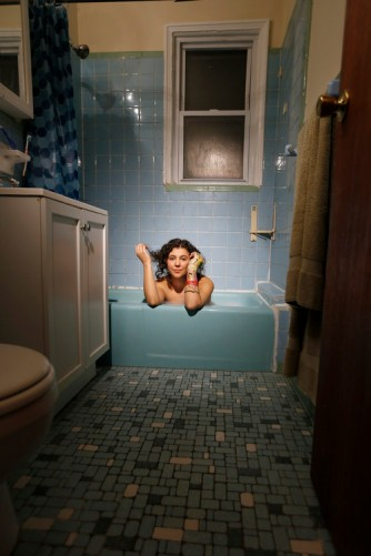 "NEW YORK - SUNDAY NEWS: Brooklyn artist Siobhan O'Loughlin inside of her most recent performance space, Astoria, Queens, NY, Friday, January 27, 2017. Using a stranger's bathtub as her performance space, O'Loughlin performs an interactive show naked called, ""Broken Bone Bathtub,"" . PICTURED: (Angel Chevrestt, 646.314.3206)"